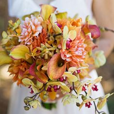 Brides.com: . Arrangement of phalaenopsis orchids, mango callas, dahlias, mokara orchids, and tulips. Bouquet by Waterlily Pond