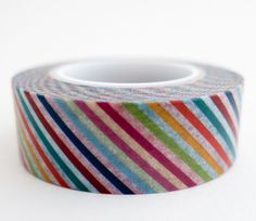 Single roll of washi tape with diagonal rainbow stripes pattern. Great for scrapbooking, gift wrapping, decorating cards and envelopes and more! Add a little dash of cuteness to any crafting project!