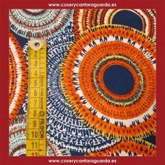 Tela con motivos de circulos en varios colores, doble ancho, corte desde 25cms. Corte desde 25cms x 145cms