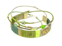 Spring fashion!  Beautiful fashionable bangle bracelets. Gold plated with silk and charms. Get yours on www.sophisticatedgold.nl