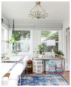 Love this home office and the blue rug adds to the fun mood.