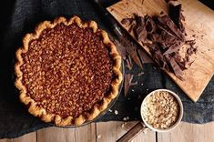 """This pie has slowly but surely become a sort of cult favorite in the pie shop. We loved it from the start for its oatmeal–chocolate chip cookie quality; it's like a pie version of that classic recipe. In olden days, this pie (minus the chocolate) was dubbed """"poor man's pecan pie"""" because oats are far less expensive than pecans. We up the ante by adding a decadent layer of dark chocolate ganache on the bottom."""