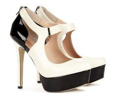 Black and cream Mary Jane pumps.