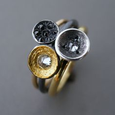 Rings in sterling silver, 14k gold, 18k gold, 24k gold, and diamonds.