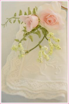 Delicate roses and vintage napkins.  rosemary-thyme.blogspot.com