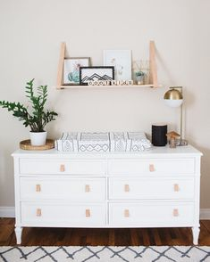 dresser changing table with overhead shelf