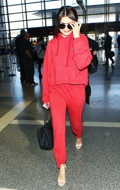 Selena Gomez // Little Things Celebs Do to Instantly Step Up Their Airport Style via @WhoWhatWear