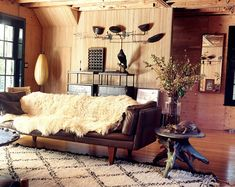 I like this room but minus the fur and leather couch. Its got such an earthy rustic feel to it