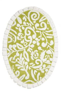 Dena Home 'Ikat' Bath Rug oval tufted-cotton bath mat styled with a lush green paisley design and white fringe trim.