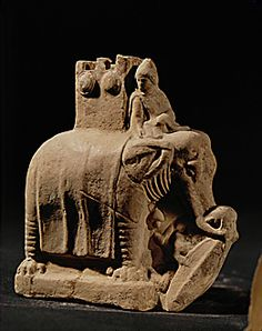 This mid 2nd century BC terracotta figurine comes from Myrina on the isle of Lemnos, Greece. It is a detailed scene of a war elephant trampling on a Galatian with his typically Celtic oval shield. This scene is from the so called 'Elephant battle' of Antiochos I of the Seleucid Empire. The use of elephants in battle was a common sight on Hellenistic battlefields in this period. This practice originated from Alexander the Great's encounter with elephants in India at the battle of the…