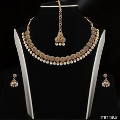 Beautiful necklace set with matching pair of earrings and maang tika