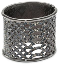 Hinged cuff bracelet in etched snakeskin pattern featuring two-tone crystal-adorned cut-outs at front,