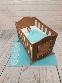 Baby in a Cot Baby Shower Cake... love it when you get to design the cake #baby #shower #cake #cot #ACDN #babyboy #crib #craddle #blue