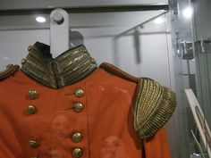 Officers Jacket, top detail of insignia. British officers jackets during the Napoleonic wars could have their uniforms tailored themselves as long as they applied the correct insignia to reconise their rank within the Infantary.   Such as fabrics etc.  Displayed at the DLI in Durham, count durham.