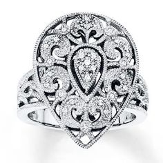 The weather outside is frightful, but this diamond feather ring is just delightful.