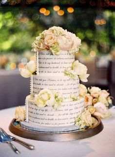 Wedding cake decorated with quotes from romantic literature......I must have you!