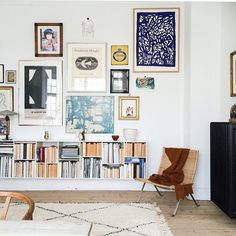 Gallery wall and bookshelf in modern bohemian style living room