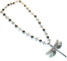 Pyrite and Celtic Knot Dragonfly Necklace. Starting at $20