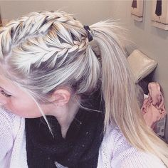 Triple braided pony tail, blonde long hair with braids