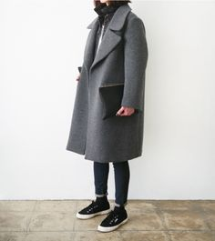 Oversized coat and pair of black Superga's to top it off.
