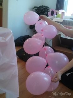 """How To String Balloons together for decorating a party!  This goes beautifully with a """"streamer waterfall!""""  DIY party on a budget!"""