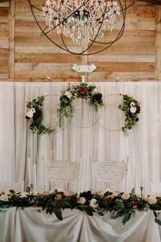 Romantic and elegant wedding head table with garlands of gorgeous greenery and rings of floral sprays. Professional Photo by Alyssa Shrock Photography wedding rings Cross Creek Ranch - Wedding Head Table Inspiration Head Table Wedding Decorations, Head Table Backdrop, Bridal Party Tables, Head Table Decor, Wedding Reception Backdrop, Barn Wedding Venue, Wedding Table, Wedding Ideas, Diy Wedding