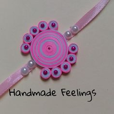 paper quilled rakhi Paper Quilling Jewelry, Paper Quilling Designs, Quilling Art, Paper Jewelry, Handmade Rakhi Designs, Handmade Design, Hobbies And Crafts, Diy And Crafts, Paper Crafts