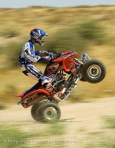 ATV Wheelie by photonyd, via Flickr