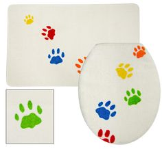 Paws Galore Bathroom Set at The Animal Rescue Site | A panoply of peppy paws really ties your bathroom together. An absorbent bathmat greets your bare feet when you hop out of the shower, while the toilet seat cover echoes the cheery paw motif. Rug and seat cover available separately or as a set.