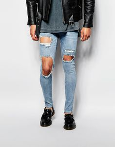 Image 1 ofASOS Extreme Super Skinny Jeans With Extreme Open Rips In Mid Blue