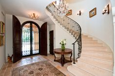wrought-iron-stair-railing-Entry-Traditional-with-arched-windows ...