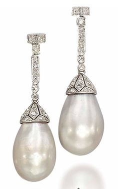 A PAIR OF BELLE EPOQUE NATURAL PEARL AND DIAMOND EAR PENDANTS. 1910s