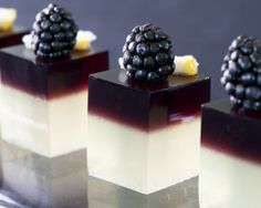 Bramble cocktail shots with blackberries