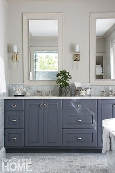 Master bathroom with dark gray vanity, light gray floors, two mirrors over the double sink and off-white walls floors Galleries - New England Home Magazine Light Grey Bathrooms, Dark Gray Bathroom, Master Bathroom Vanity, Double Sink Bathroom, Bathroom Vanity Lighting, Double Sinks, Modern Bathroom, Mirror Vanity, Gray Bathroom Vanities