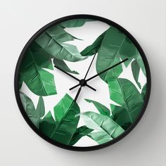 """Tropical Palm Print Wall Clock. Bahamas, Banana plant, leaves, wild, green, cushion, home decor, palm leaves, floral, green. Banana Leaf print, inspired by Hinson's """"Martinique"""" wallpaper, featured in Beverly Hills Hotel."""