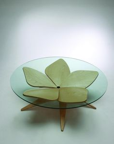 Hana Table: The flower table by Japanese designer Shige Hasegawa uses origami and comes with five petal-shaped plywood legs to hold the glass top.
