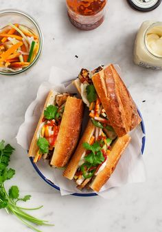 Seared Tofu Banh Mi The BEST banh mi recipe! Fresh baguette stuffed with ginger-lime marinated tofu tangy pickled veggies fresh cilantro mayo and sriracha makes an amazing crave-worthy sandwich. Banh Mi Recipe, Banh Mi Sandwich, Homemade Sandwich, Marinated Tofu, Healthy Sandwiches, Along The Way, Vegetarian Recipes, Vegetarian Bahn Mi, The Best