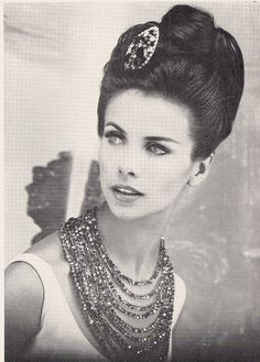 1966. LOVE the 60s brooch in the hair thing.