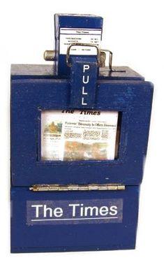 "Newspaper dispenser $42 Miniature  Blue  Front door opens  Newspaper included  Wood  2 1/4"" wide, 1 3/4"" deep, 4 1/4"" tall"