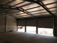 Shed Company shed inside looking at 3 roller doors, insulation in the roof. Built by Kieren Lee Plumbing & Construction 0428690696