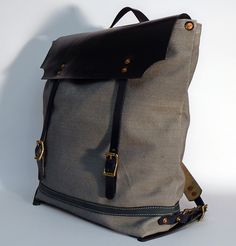 """Hand dyed cotton canvas backpack - gray with navy blue leather strap ● Size: 5,5"""" x 13,8"""" x 17,3"""" - American ● 14 cm x 35 cm x 44 cm - European ● In case of order, please contact us with the following e-mail address: info@smithandscribeco.com #cottoncanvas #backpack #handmadeineurope #handdyedcanvas #1920's #1930's #1940's #bag #canvas #copperrivet #italianleather Scribe, Canvas Backpack, Bradley Mountain, Italian Leather, Cotton Canvas, 1940s, Pirates, Navy Blue, Backpacks"""