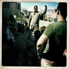 (Teru Kuwayama) Staff Sergeant Ysidiro Gonzales, surrounded by fellow Marines from Alpha company, 1st Battalion, 8th Marines, at OP Kunjak, Helmand province, Afghanistan.