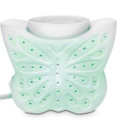 Set your heart aflutter as this whimsical butterfly shimmers in shades of the rainbow. Our perfect porcelain electric Butterfly ColorGlo ScentGlo Warmer continually rotates through a range of colors while releasing the fragrance of Scent Plus® Melts. Scent Warmers, Wax Warmers, Summer Colors, Warm Colors, Colours, Partylite, Candles Online, Home Decor Sale, Beautiful Candles