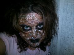 zombie make up using toilet paper (2 ply), elmer's glue, vaseline, brown, green, and maroon paint, and a safety pin.