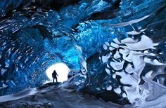 Ice caves are temporary structures that appear at the edge of glaciers. They look amazingly beautiful from the inside. This particular cave is located on the frozen lagoon of the Svínafellsjökull glacier in Skaftafell, Iceland.