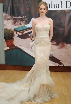 Inbal Dror Fall 2014 champagne mermaid wedding dress with no straps, slightly curved neckline, beaded lace bodice, natural waist with belt detail, tiered tulle and beaded lace skirt, and matching cathedral train.