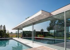 Lieven Dejaeghere's glass pool house has a concrete roof