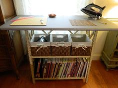 Ironing and cutting center with basket and bookshelf storage - built with a bookcase and 2 by 4 foot sheet of plywood. Buzzinbumble on the QB
