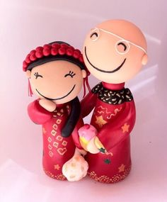 This is another style of topper I can make, this is a Chinese Bride & an English Groom. I ship world wide www.googlygifts.co.uk