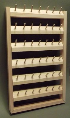 Spool organizer to build for the sewing room / office walls. - Spool organizer to build for the sewing room / office walls. Thread Storage, Sewing Room Storage, Sewing Room Organization, My Sewing Room, Sewing Rooms, Craft Storage, Bobbin Storage, Formation Couture, Thread Holder